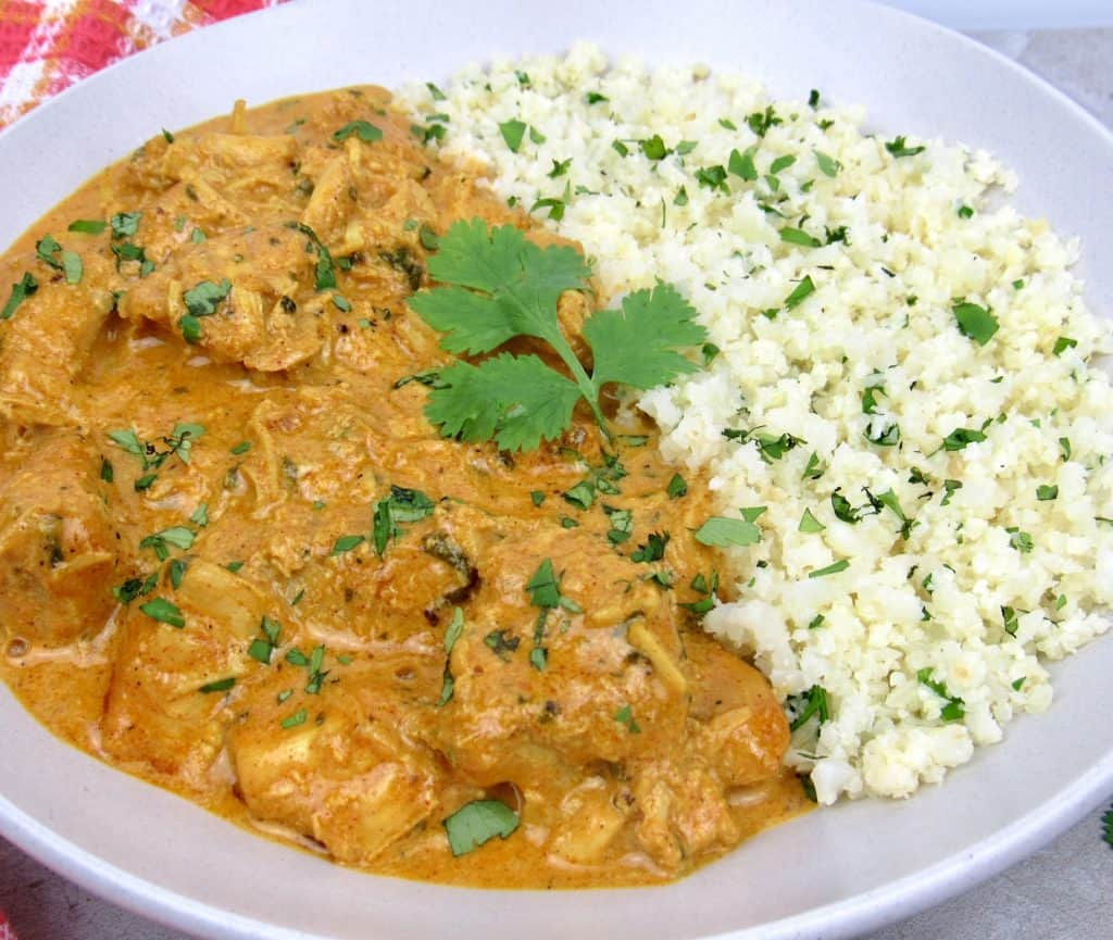 closeup of butter chicken and cauliflower rice in dish