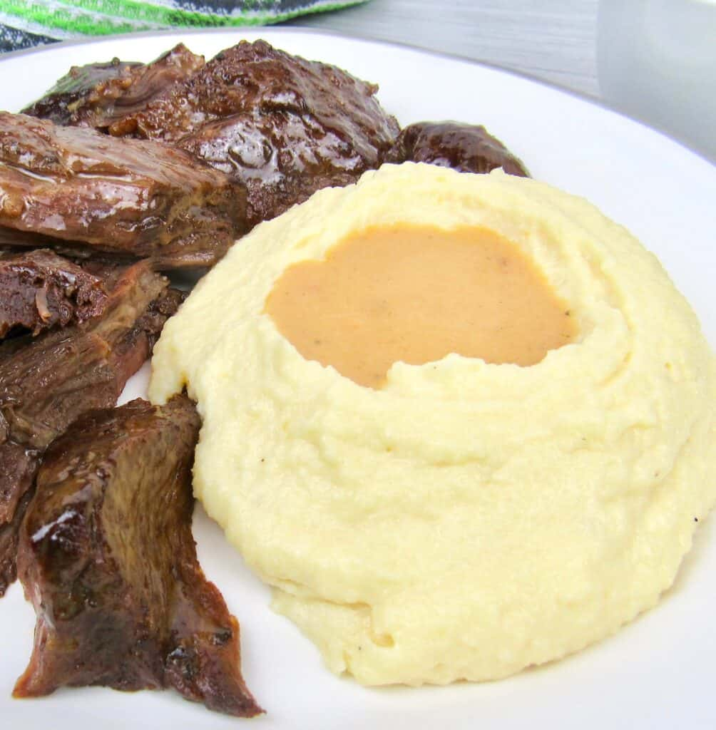 closeup of keto post roast with mashed cauliflower