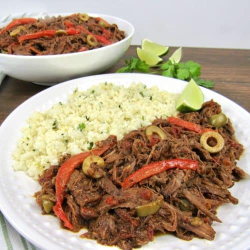 ropa vieja with cauliflower rice on white plate