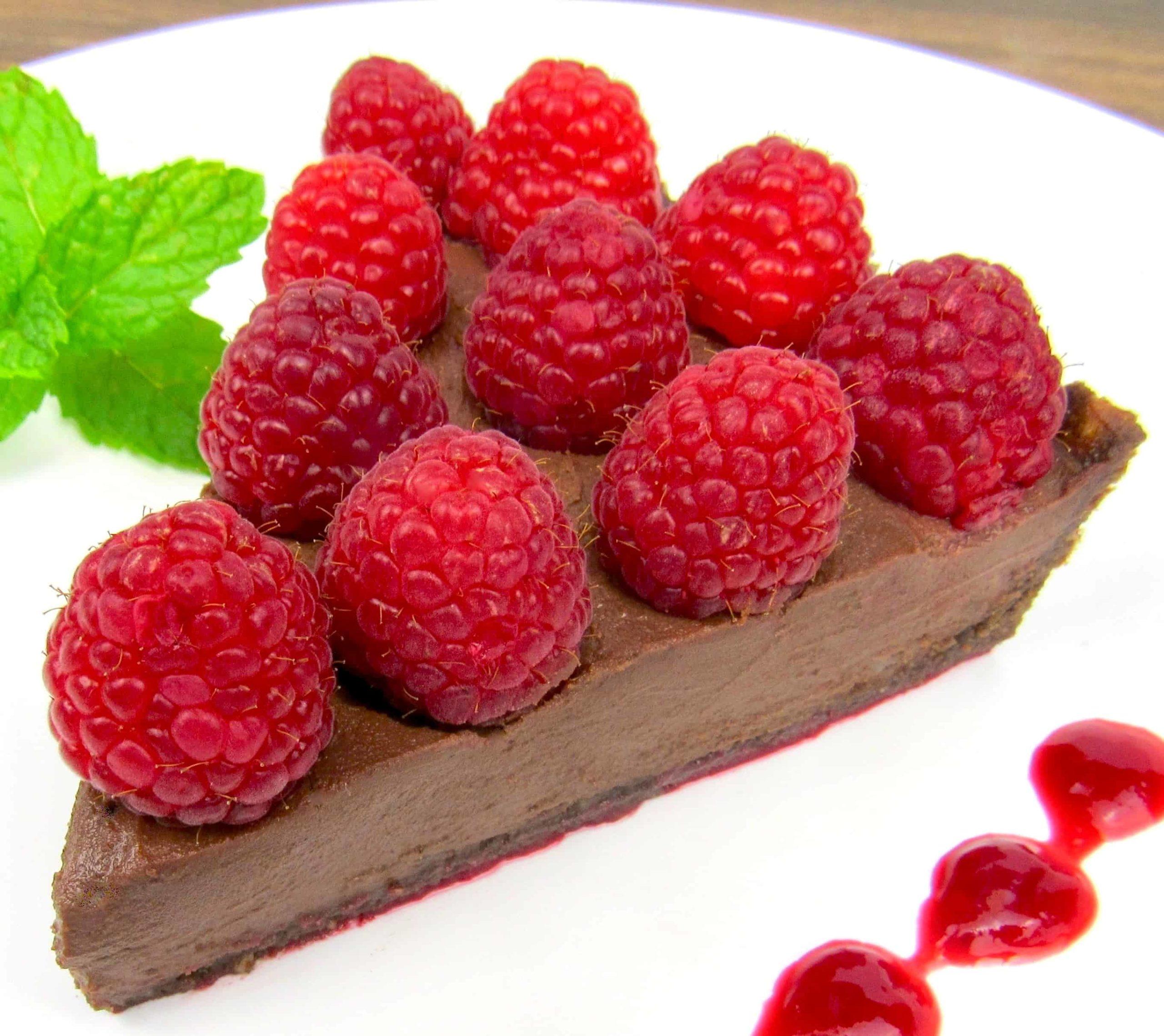slice of chocolate tart with raspberries on top