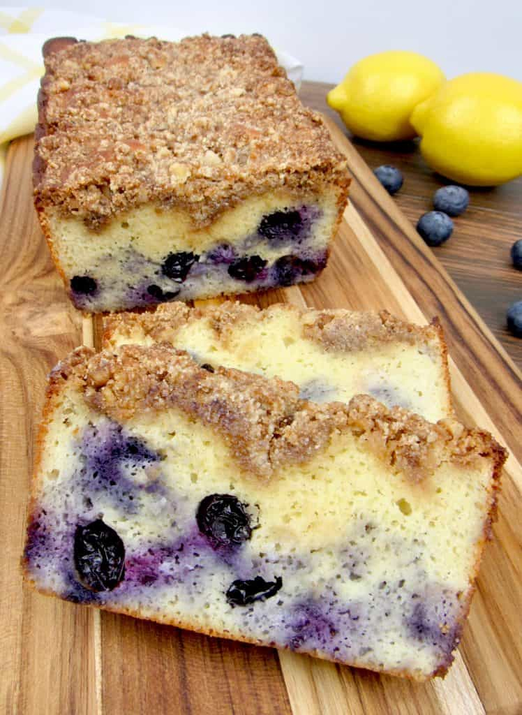 blueberry crumb loaf on cutting board with 2 slices