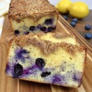 Blueberry Crumb Loaf on cutting board with lemons in background