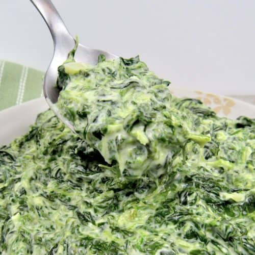 Creamed Spinach in bowl with spoonful