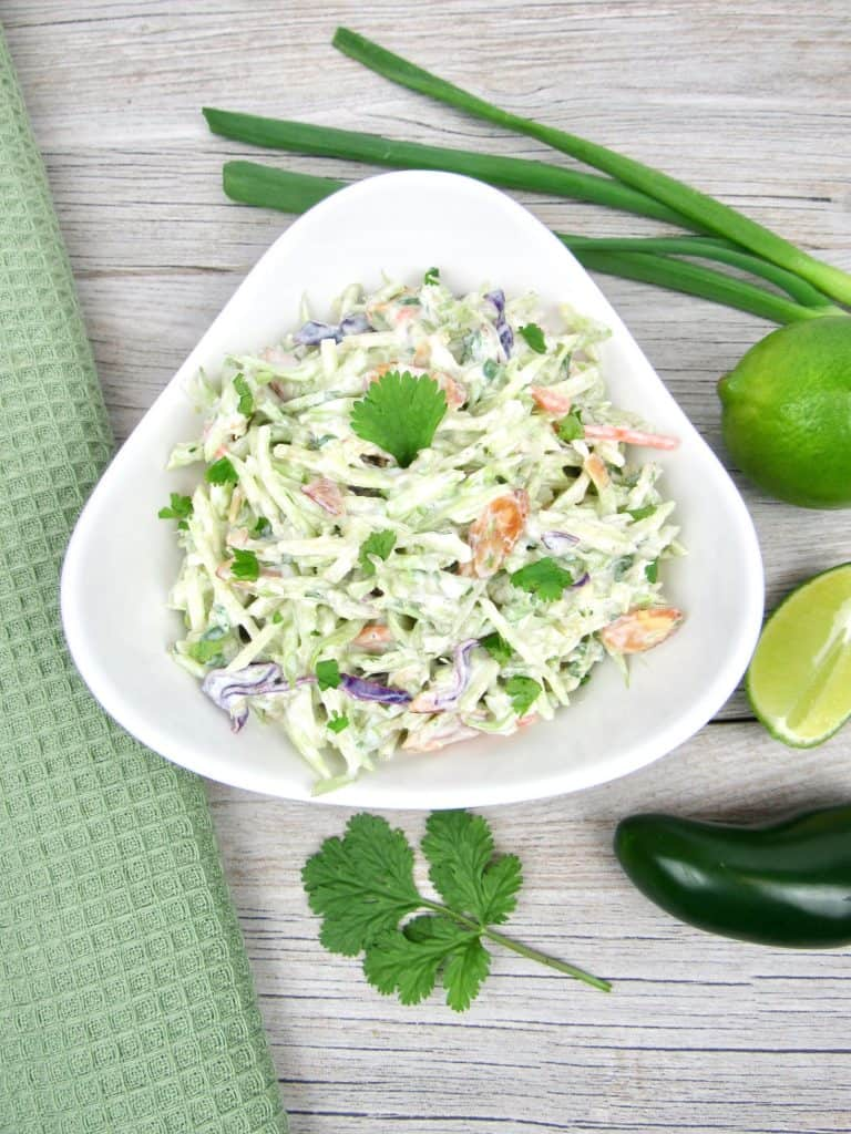 bowl of broccoli slaw with lime cilantro dressing