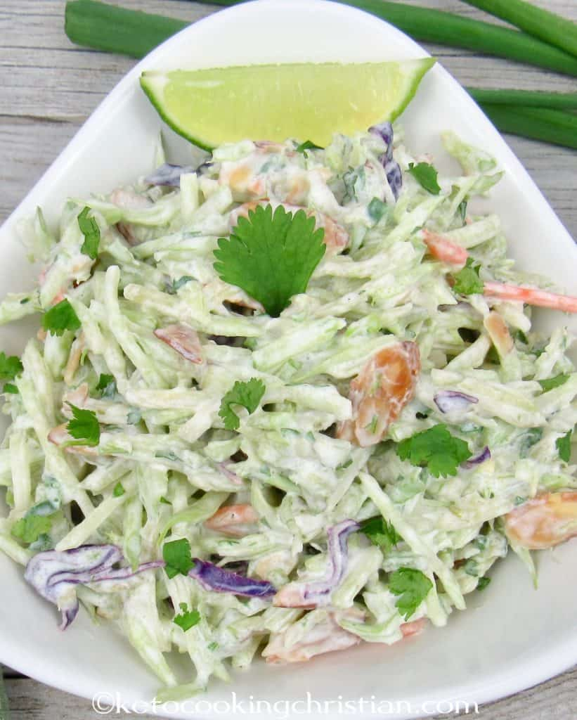 close up of bowl of broccoli slaw with lime cilantro dressing