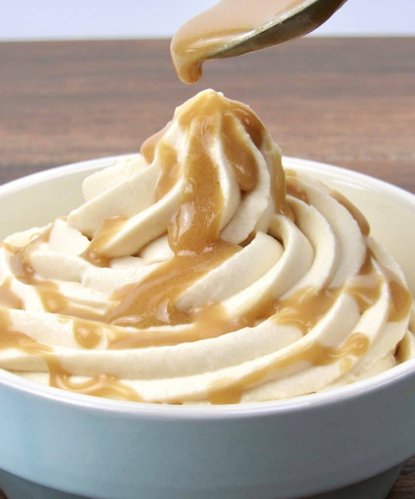 salted caramel mousse with spoon dripping caramel over the top