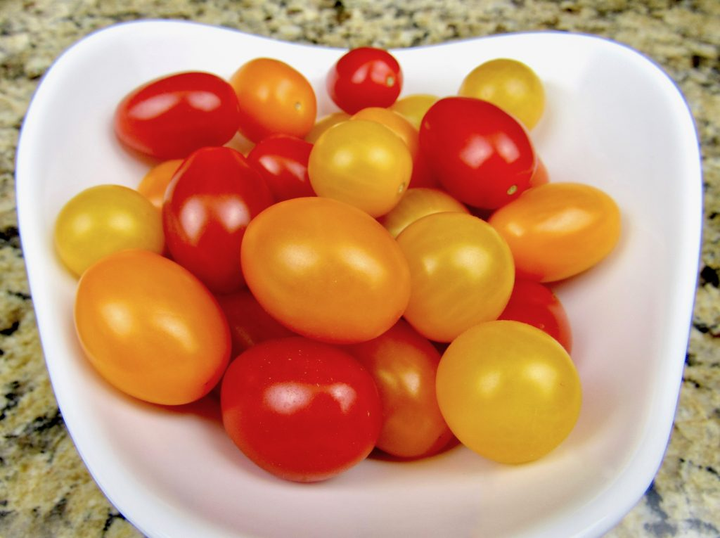 bowl with red, yellow and orange cherry tomatoes