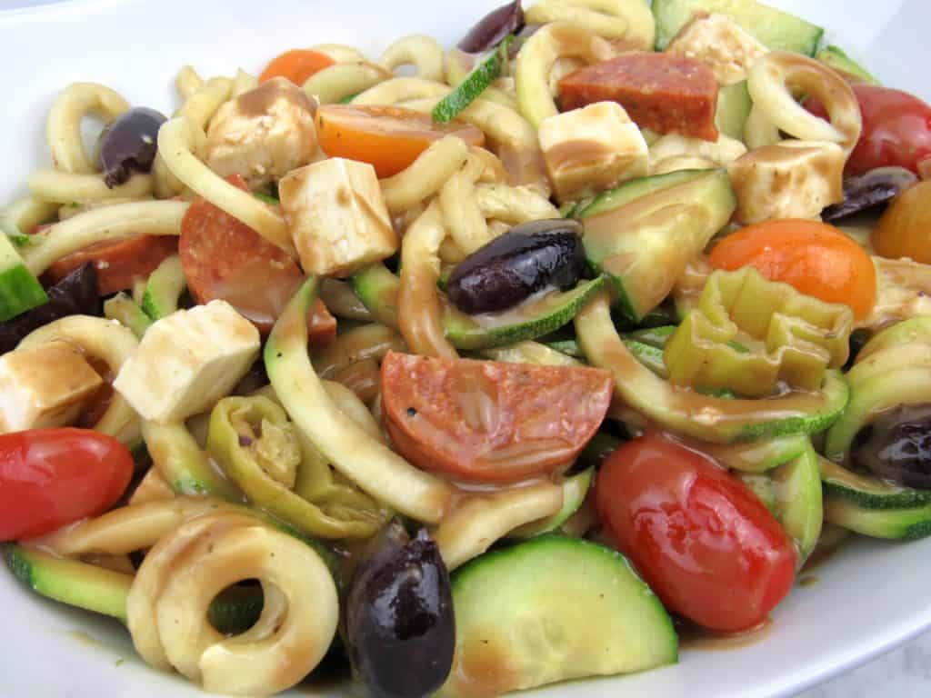 Zucchini Noodle Pasta Salad mixed with dressing