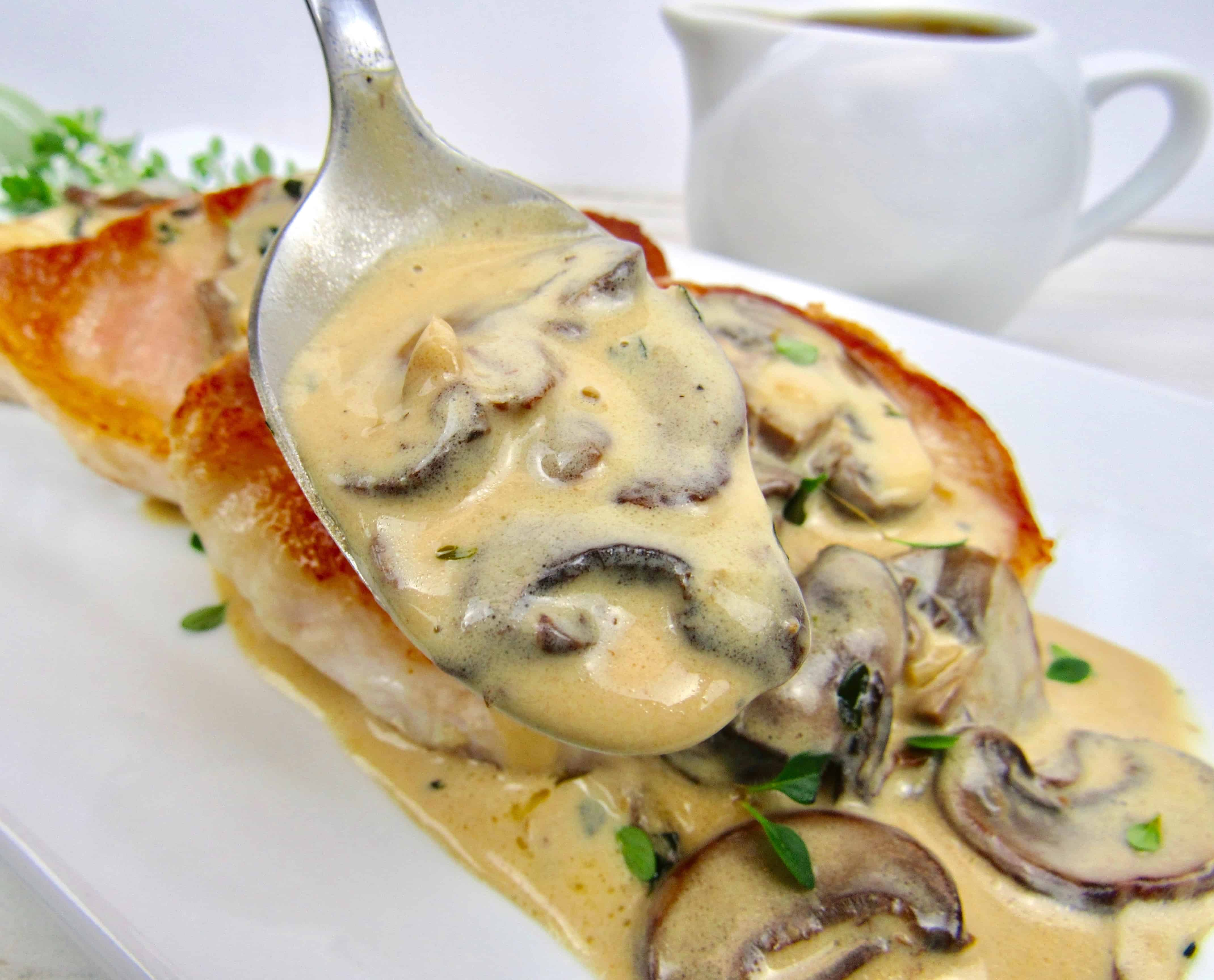 closeup of mushroom gravy held up in spoon