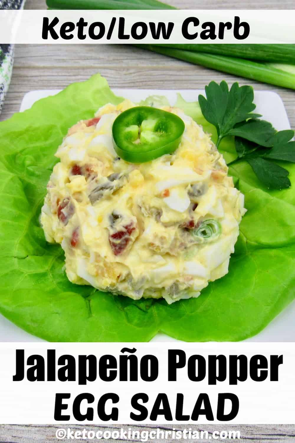 jalapeno popper egg salad on piece of lettuce on plate with pepper on top