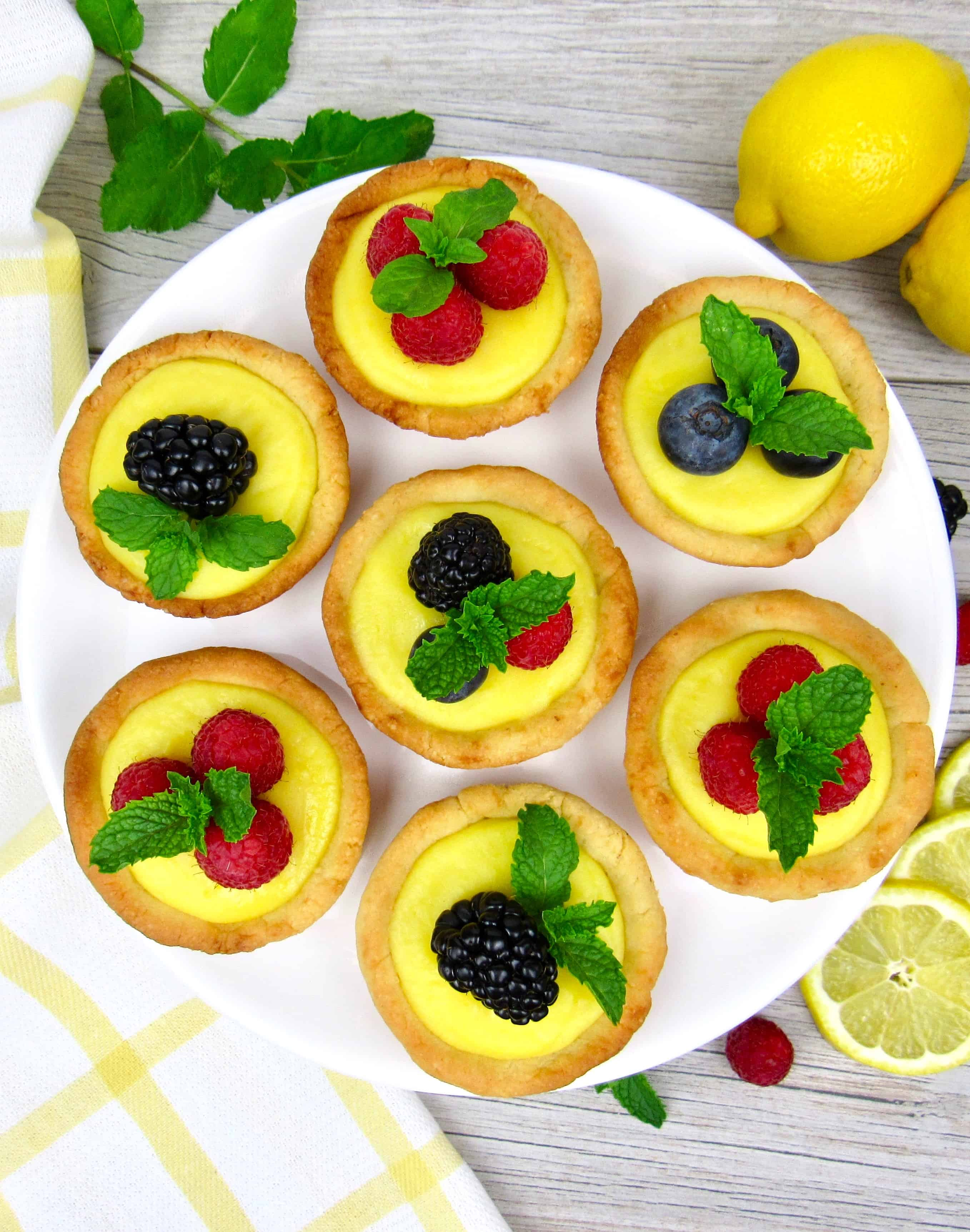 overhead view of cake stand with 7 lemon curd mini tarts