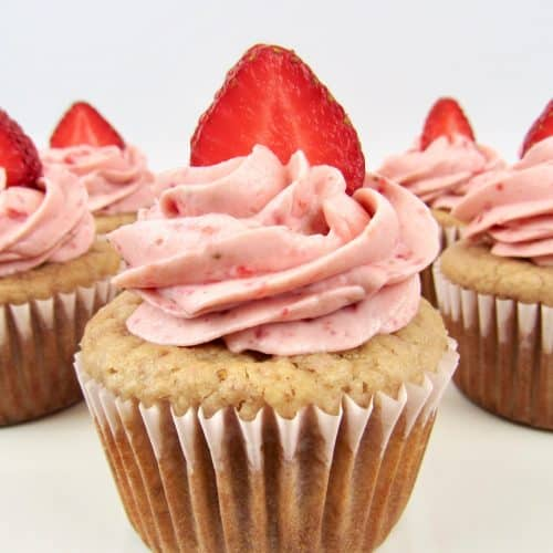 Strawberry Cupcakes with strawberry frosting and a slice of strawberry on top