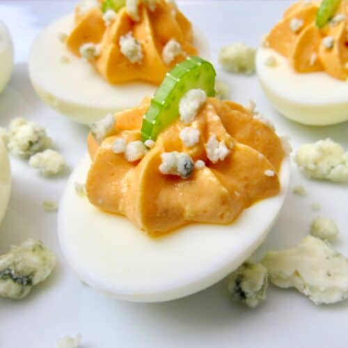 closeup of buffalo deviled eggs on white plate