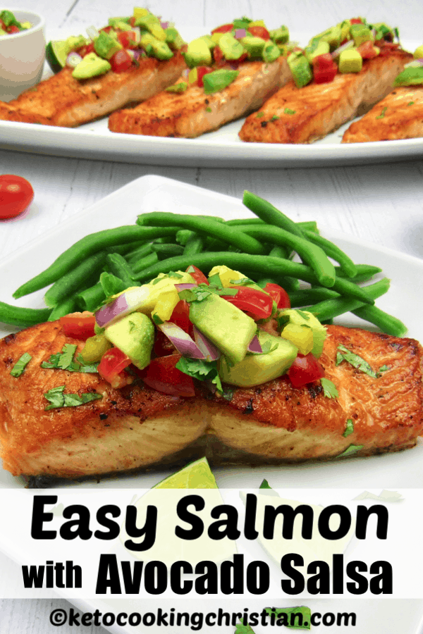 salmon on white plate with avocado salsa on top and green beans on side