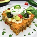 closeup slice of taco casserole with toppings