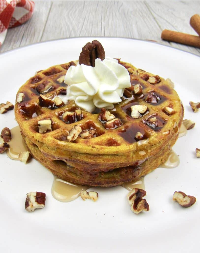 Keto Pumpkin Chaffles with Syrup, Whipped Cream, and Nuts