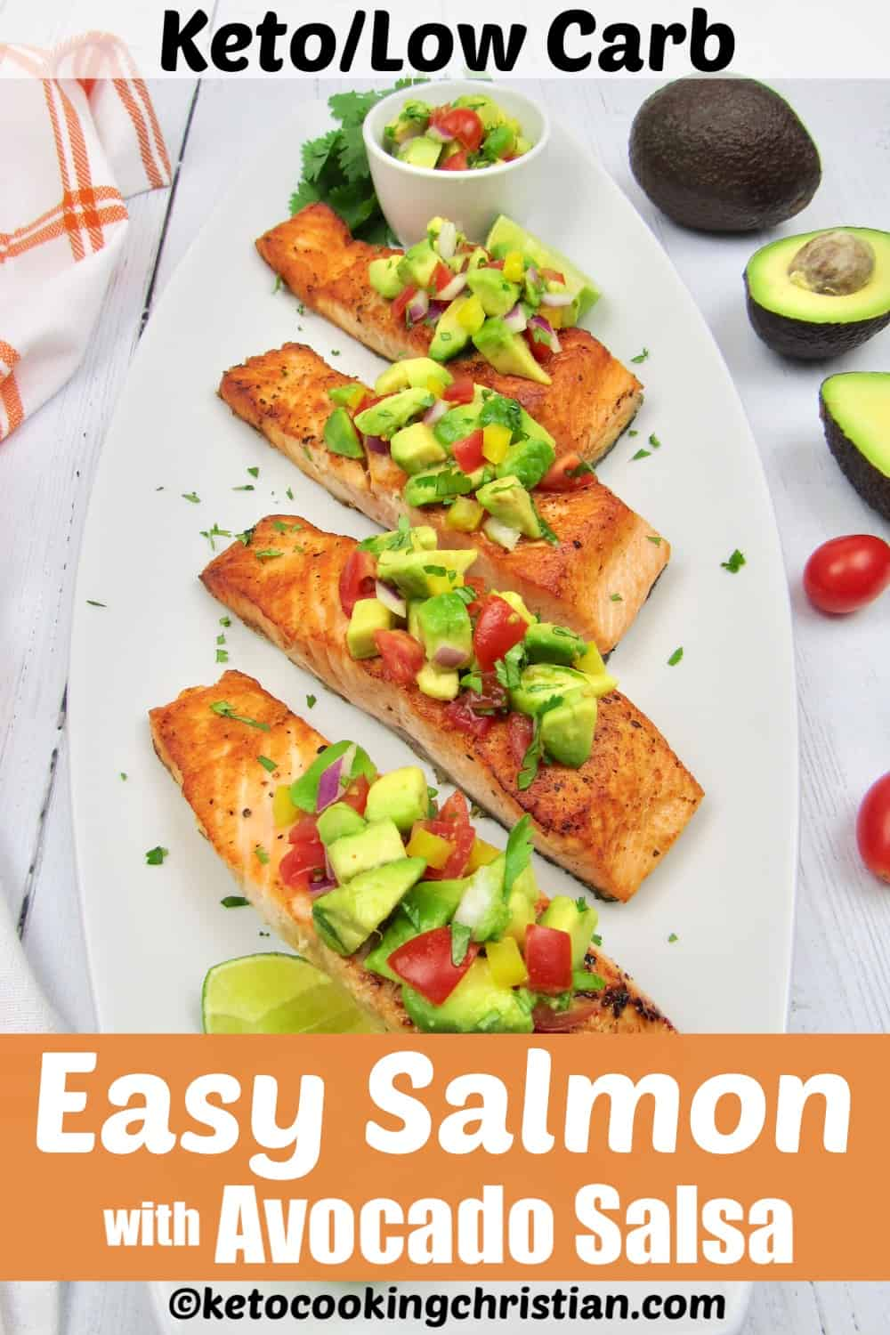 overhead view of 4 pieces salmon with avocado salsa over the top with lime wedges