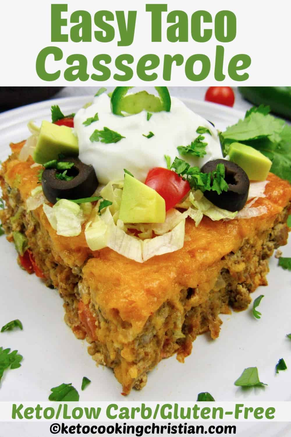 slice of taco casserole with sour cream olives and avocado on top