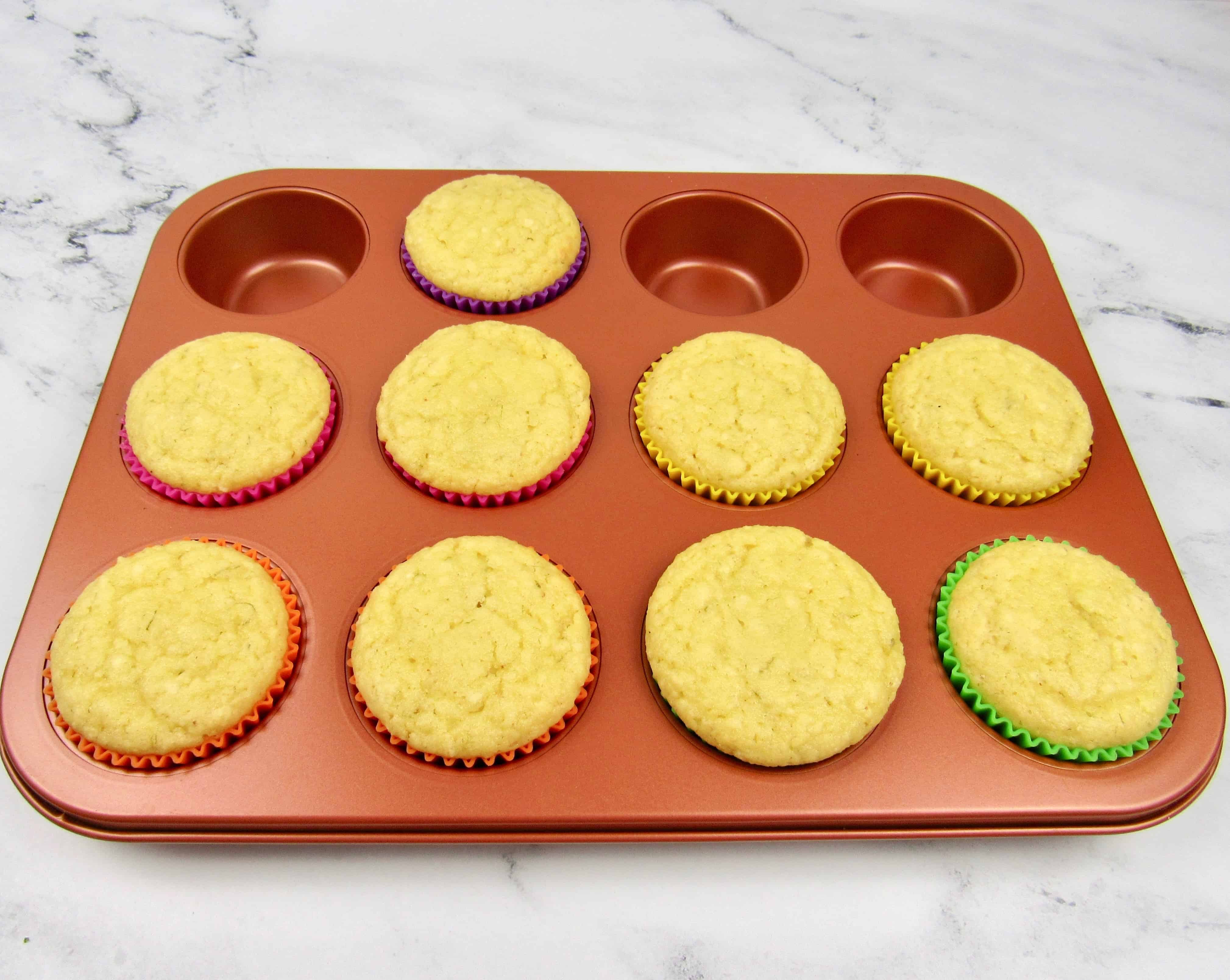copper cupcake pan with coconut cupcakes baked