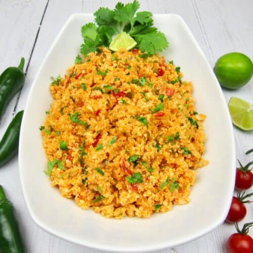 Mexican Cauliflower Rice Parsley and Lemon Slice on Plate
