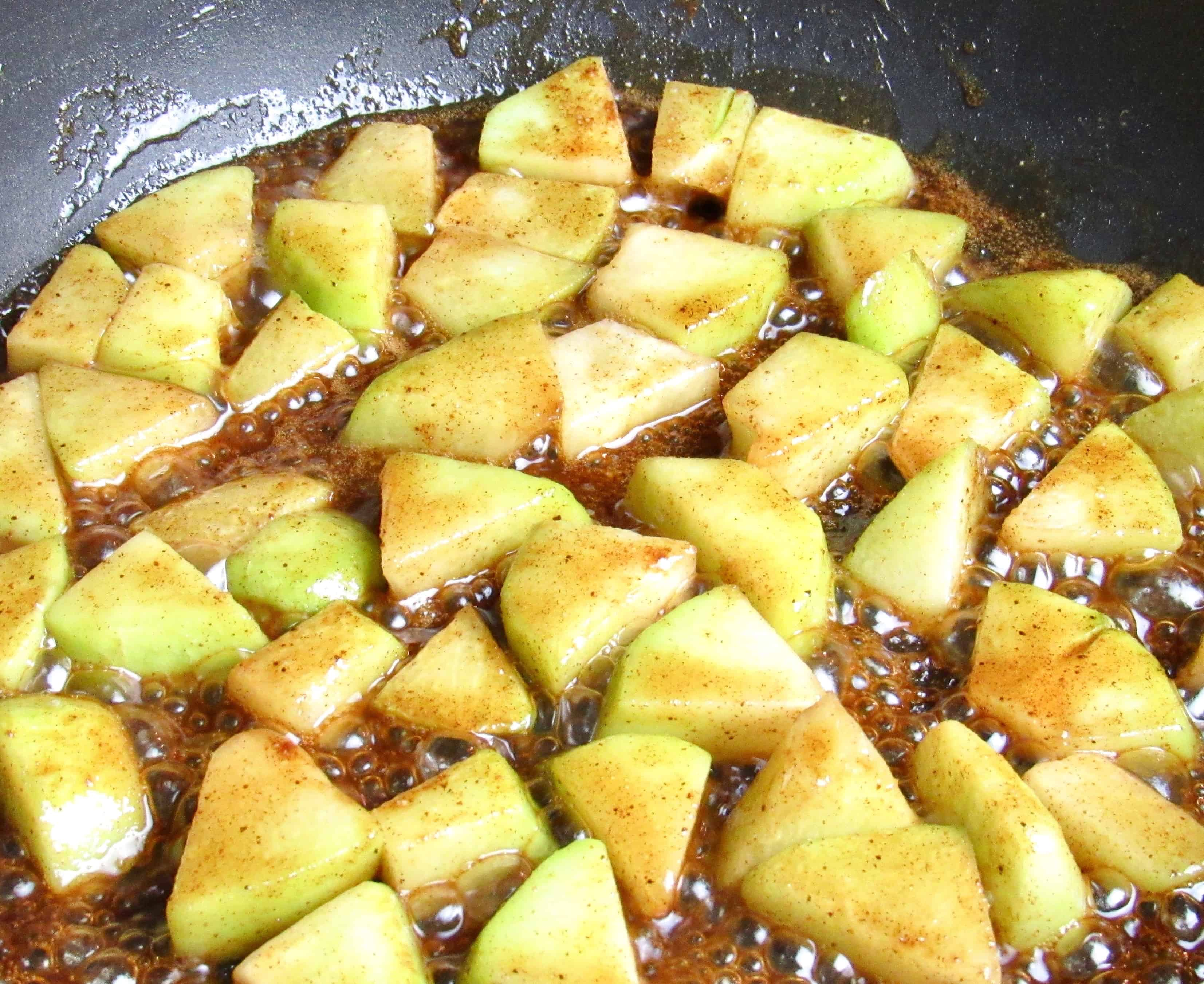 chayote squash in pan with brown sugar butter cooking