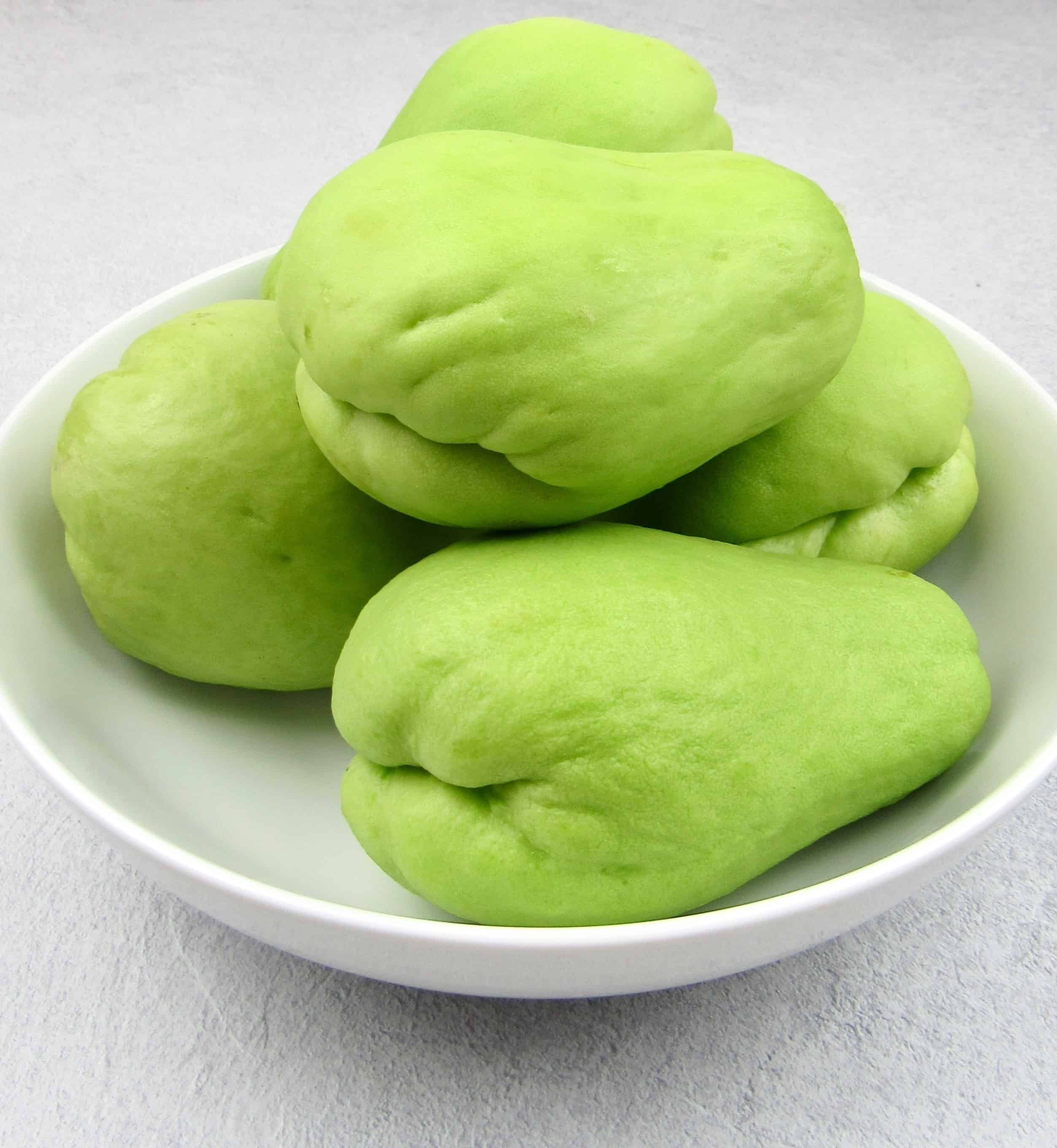 5 chayote squash in white bowl