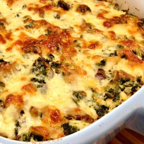 chicken, spinach and mushroom casserole baked with cheese on top