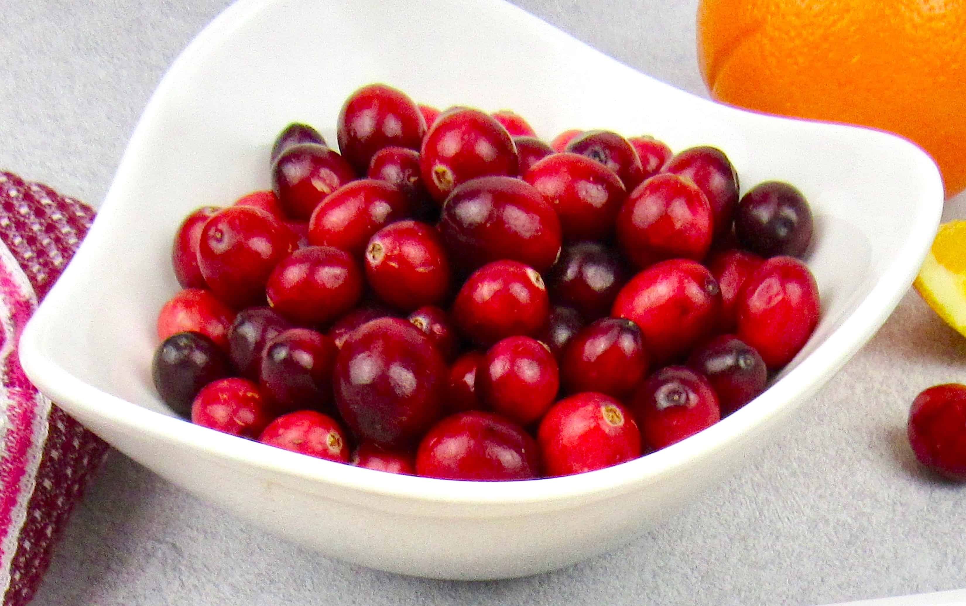 white bowl of raw cranberries