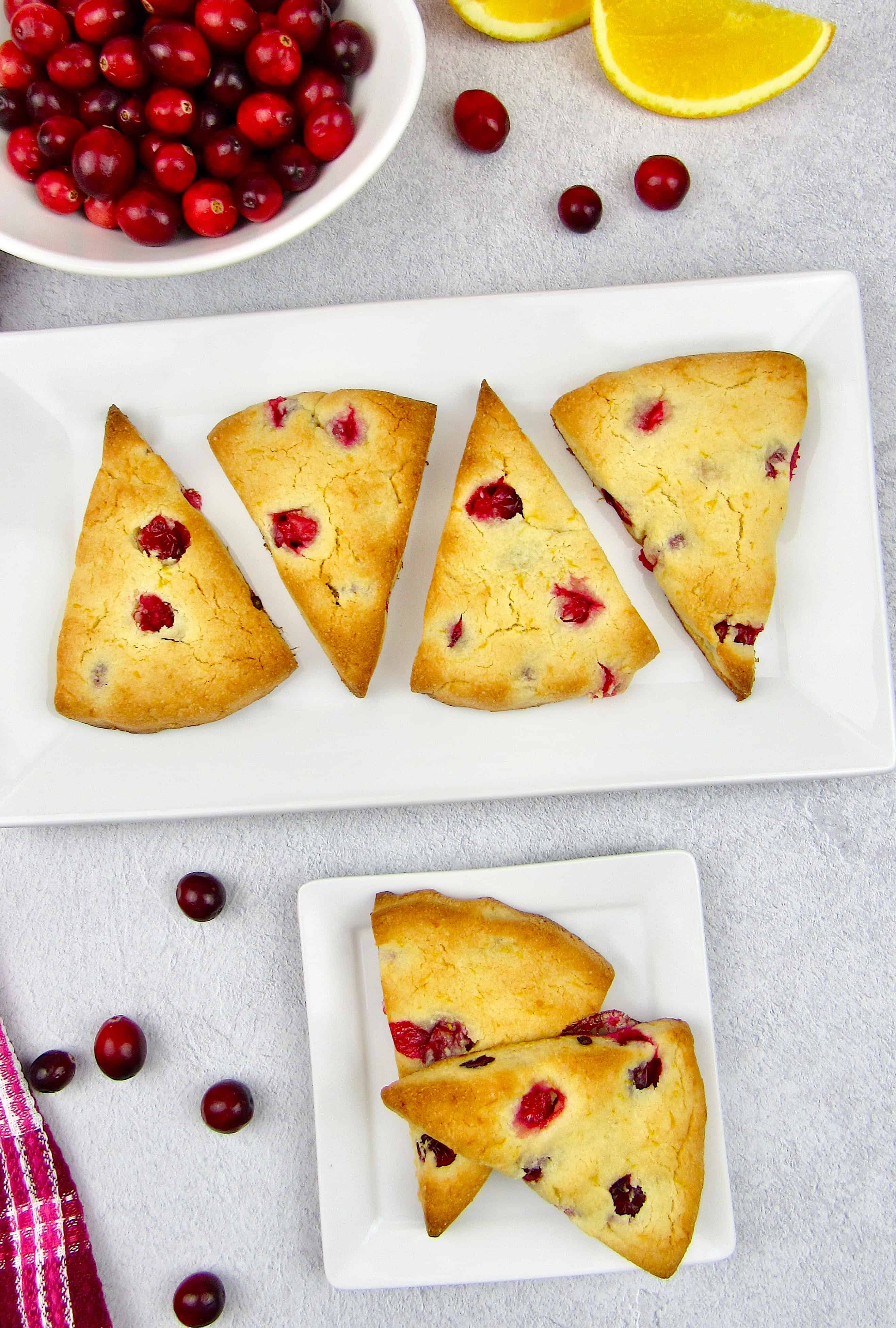 overhead view of cranberry scones on white plates