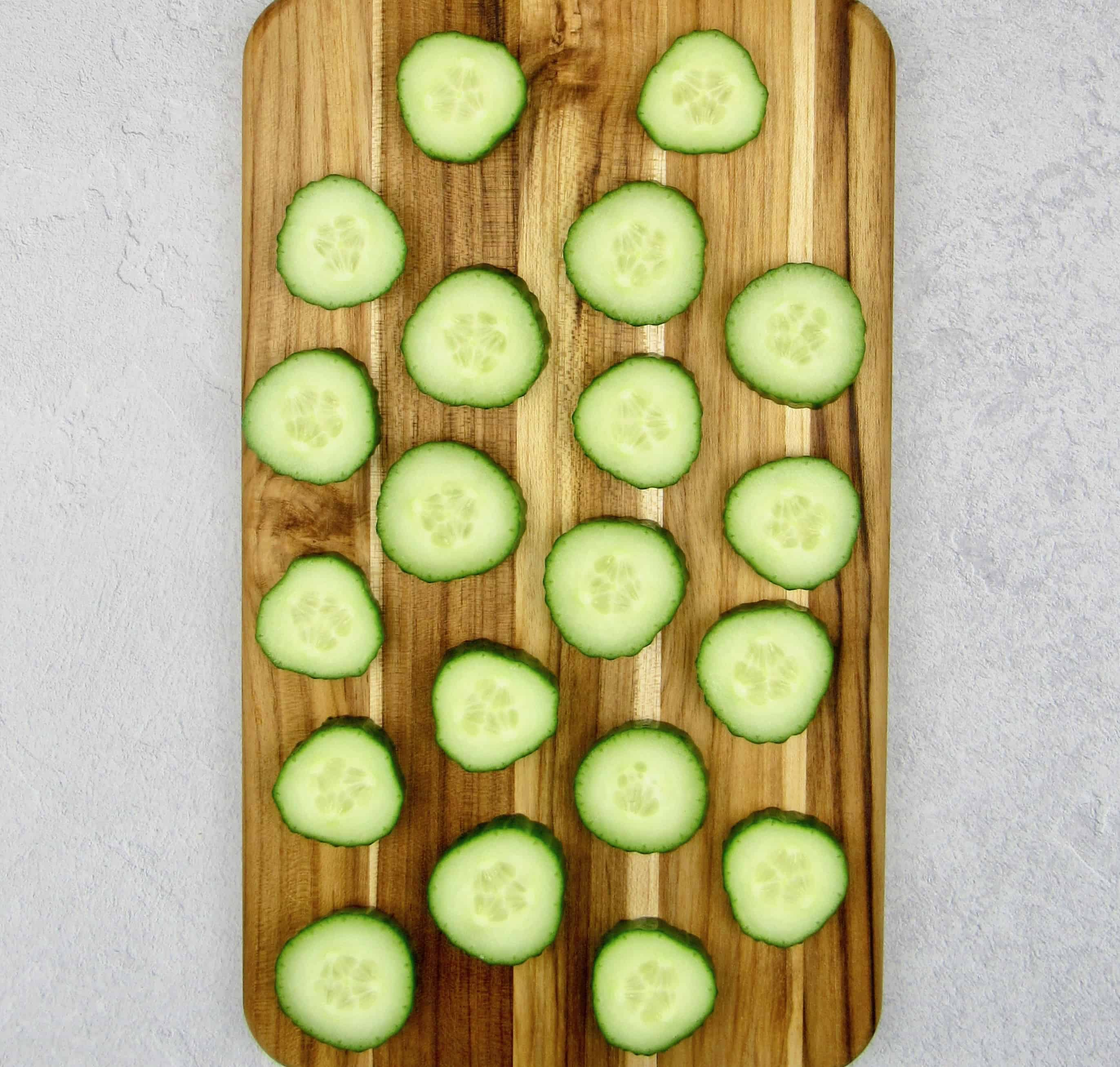 20 slices of cucumber on cutting board