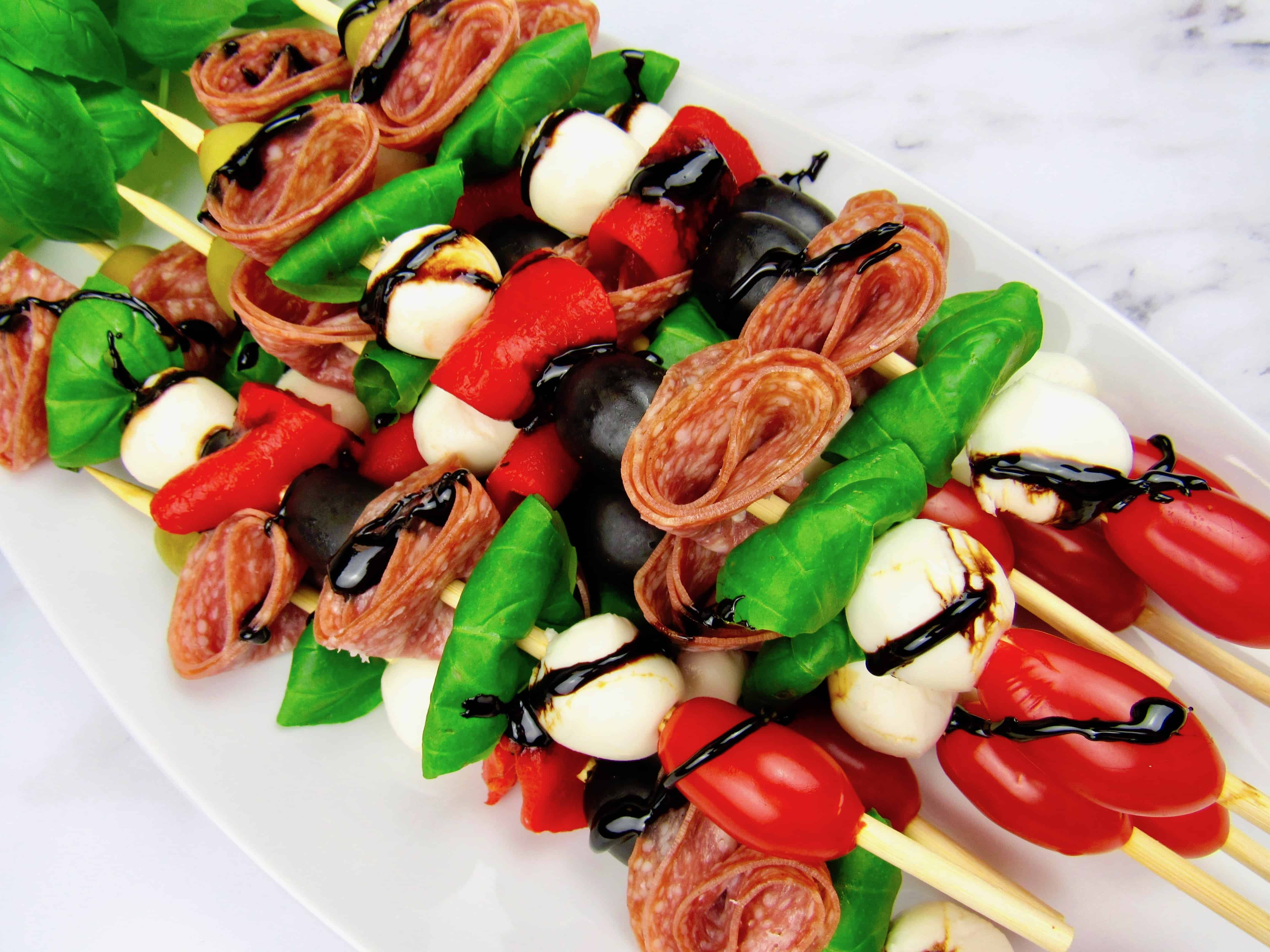 closeup of antipasti skewers with balsamic drizzle over the top