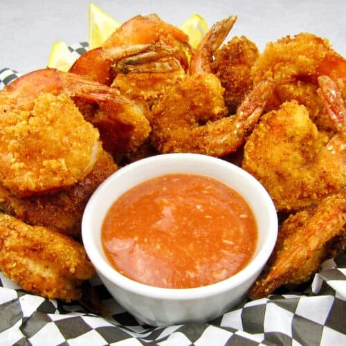 basket of fried shrimp with cocktail sauce