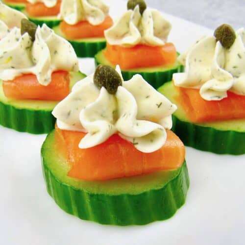 closeup of Smoked Salmon Cucumber Bites on white plate