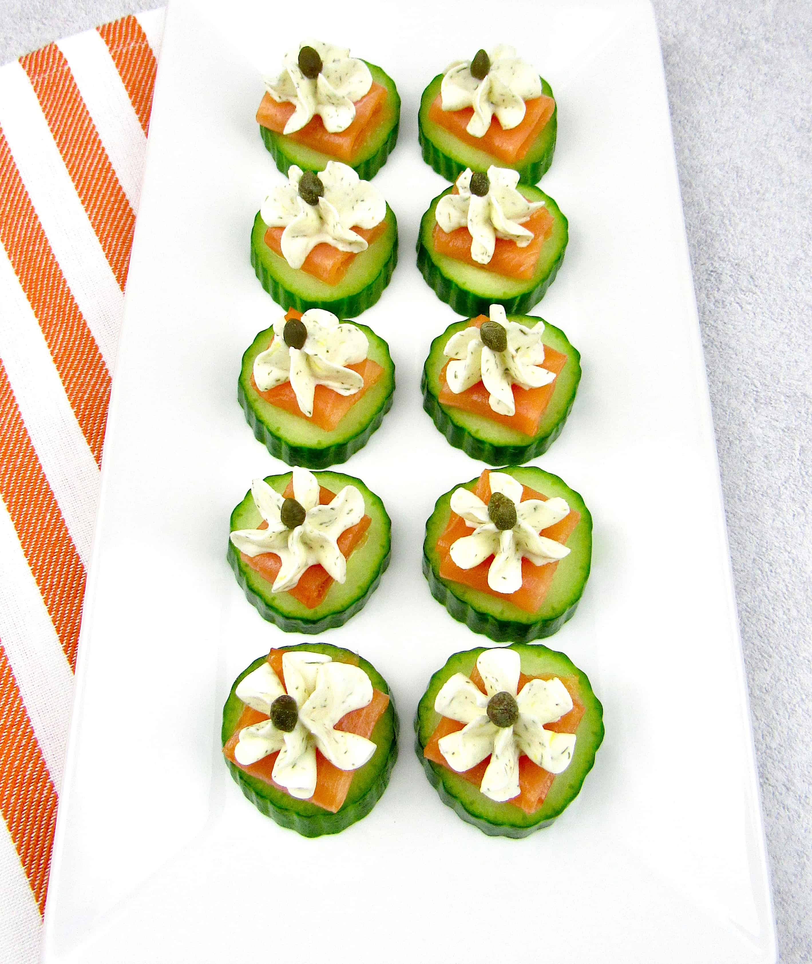 overhead view of Smoked Salmon Cucumber Bites with capers on white platter