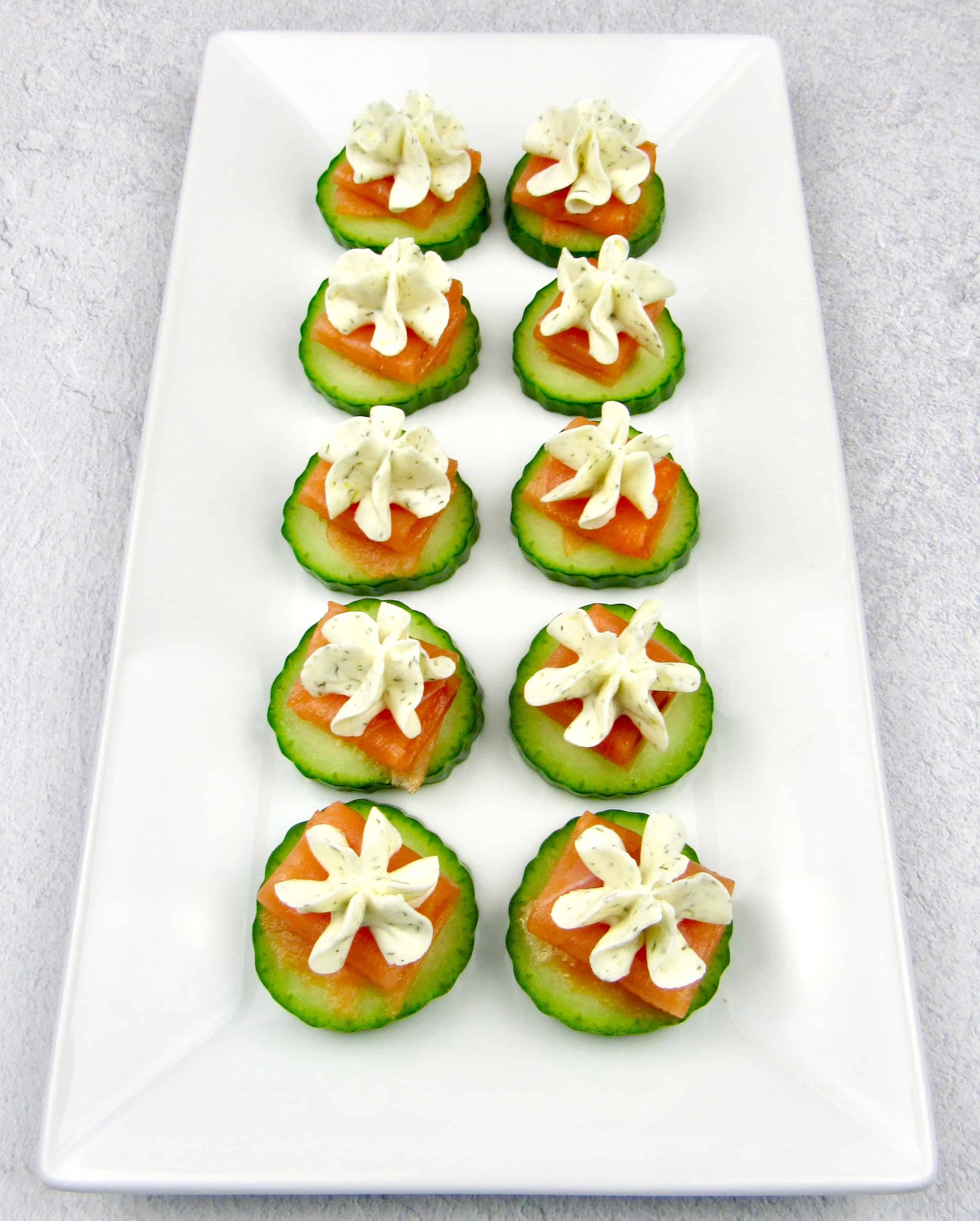 overhead view of smoked salmon cucumber bites with cream cheese topping