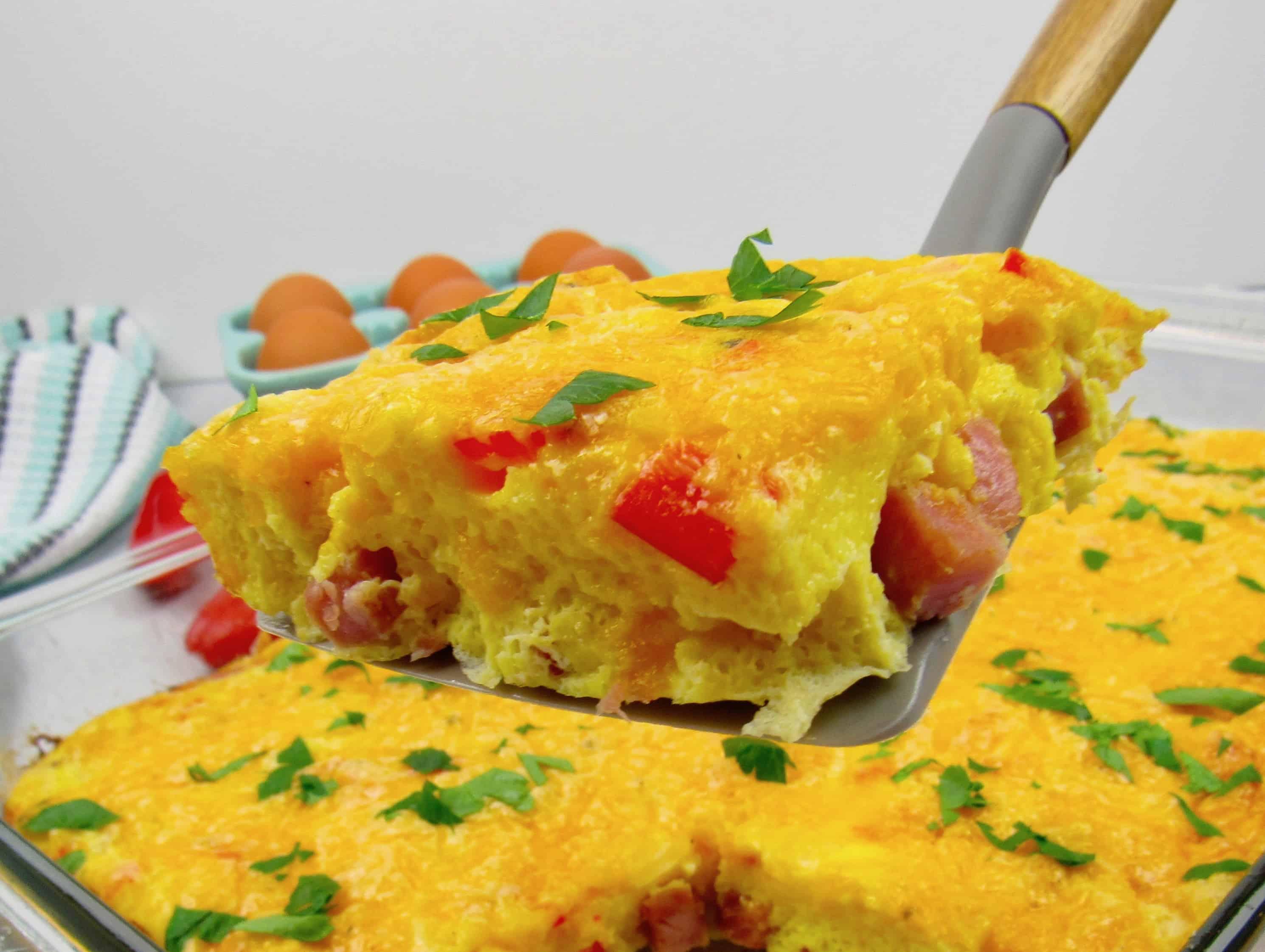 breakfast casserole slice held up with spatula