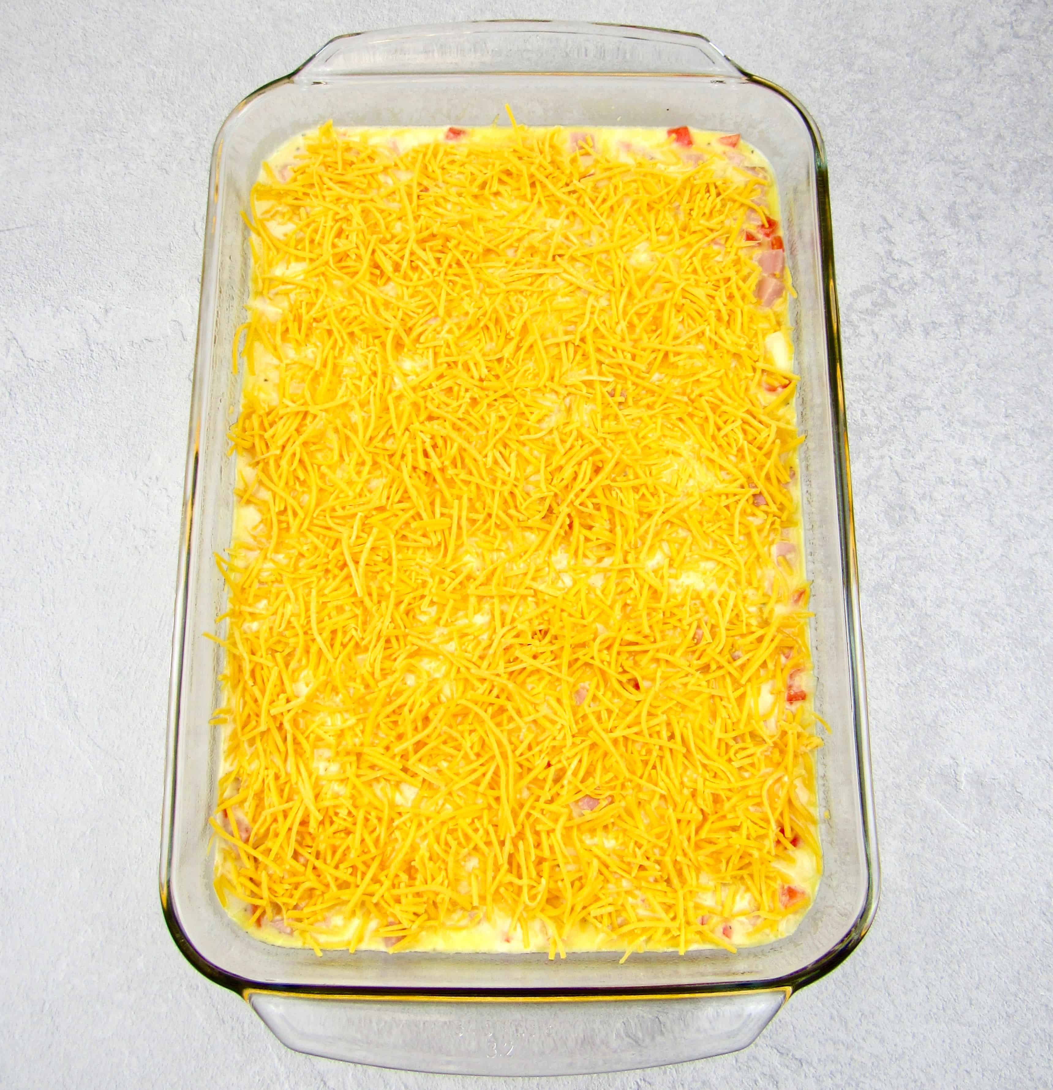 breakfast casserole with cheese on top unbaked