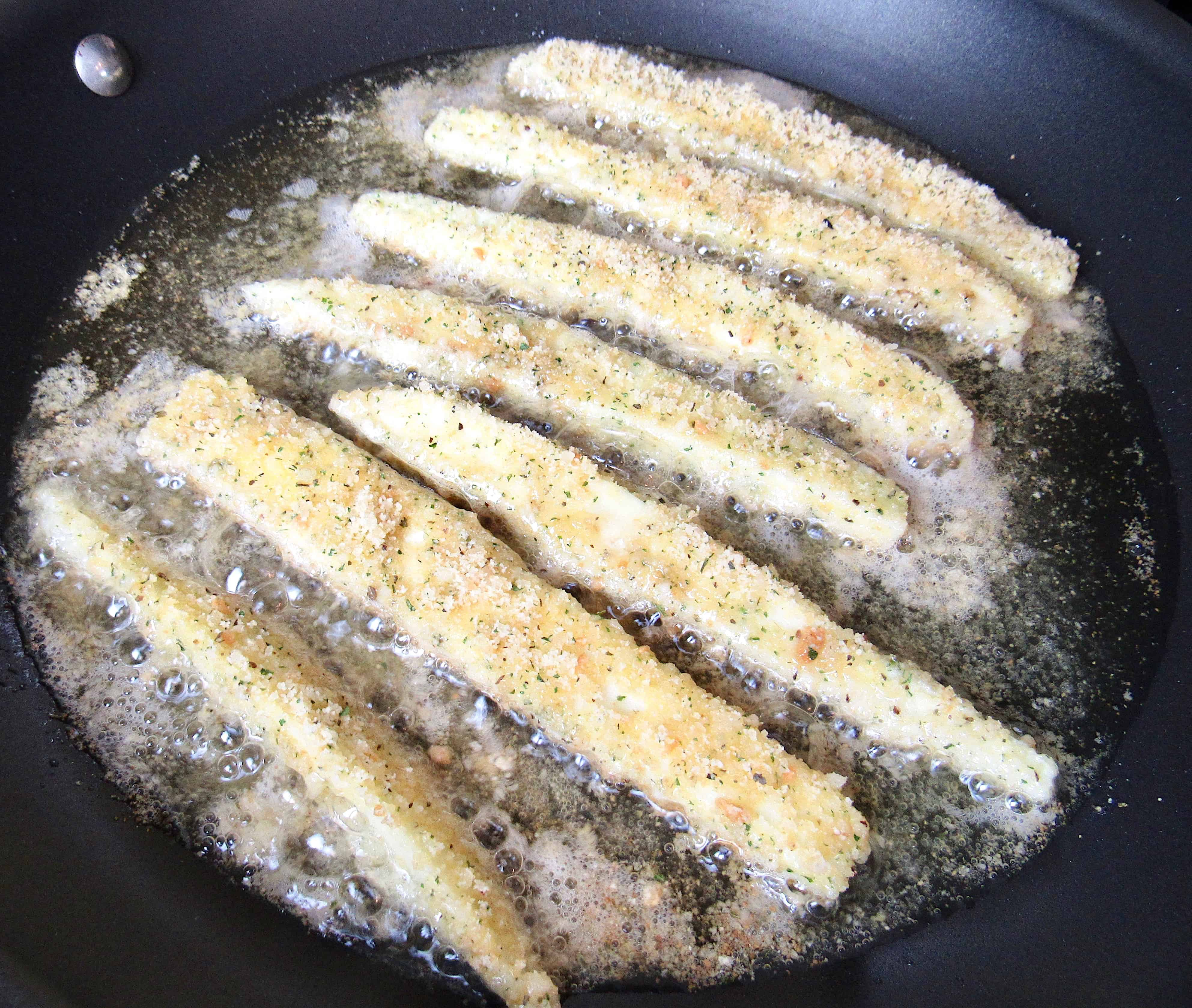 eggplant fries in frying pan
