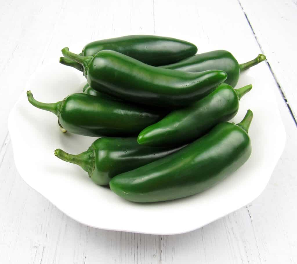 white bowl of jalapeno peppers