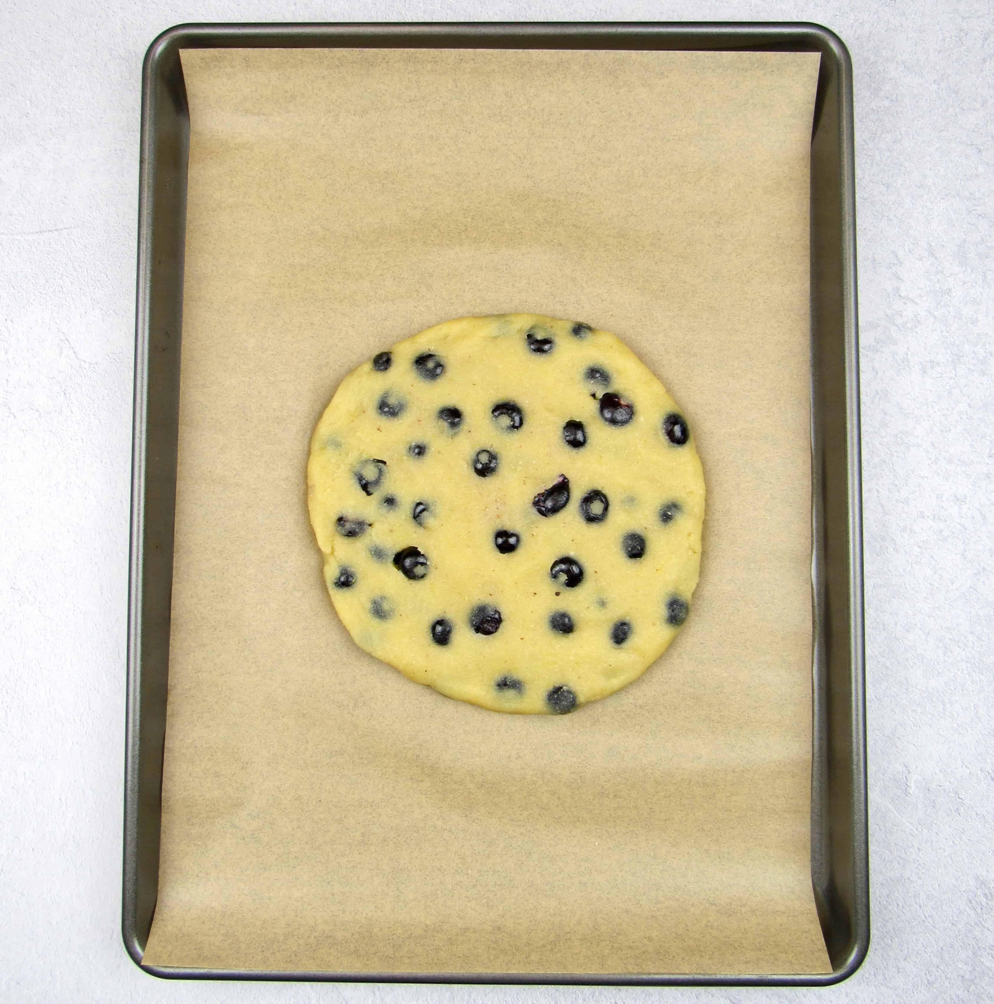 blueberry lemon scones dough disc on sheet pan