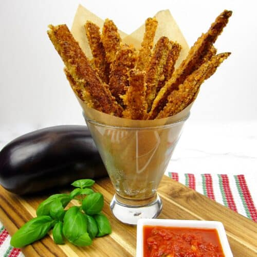 eggplant fries in glass with marinara and basil on side