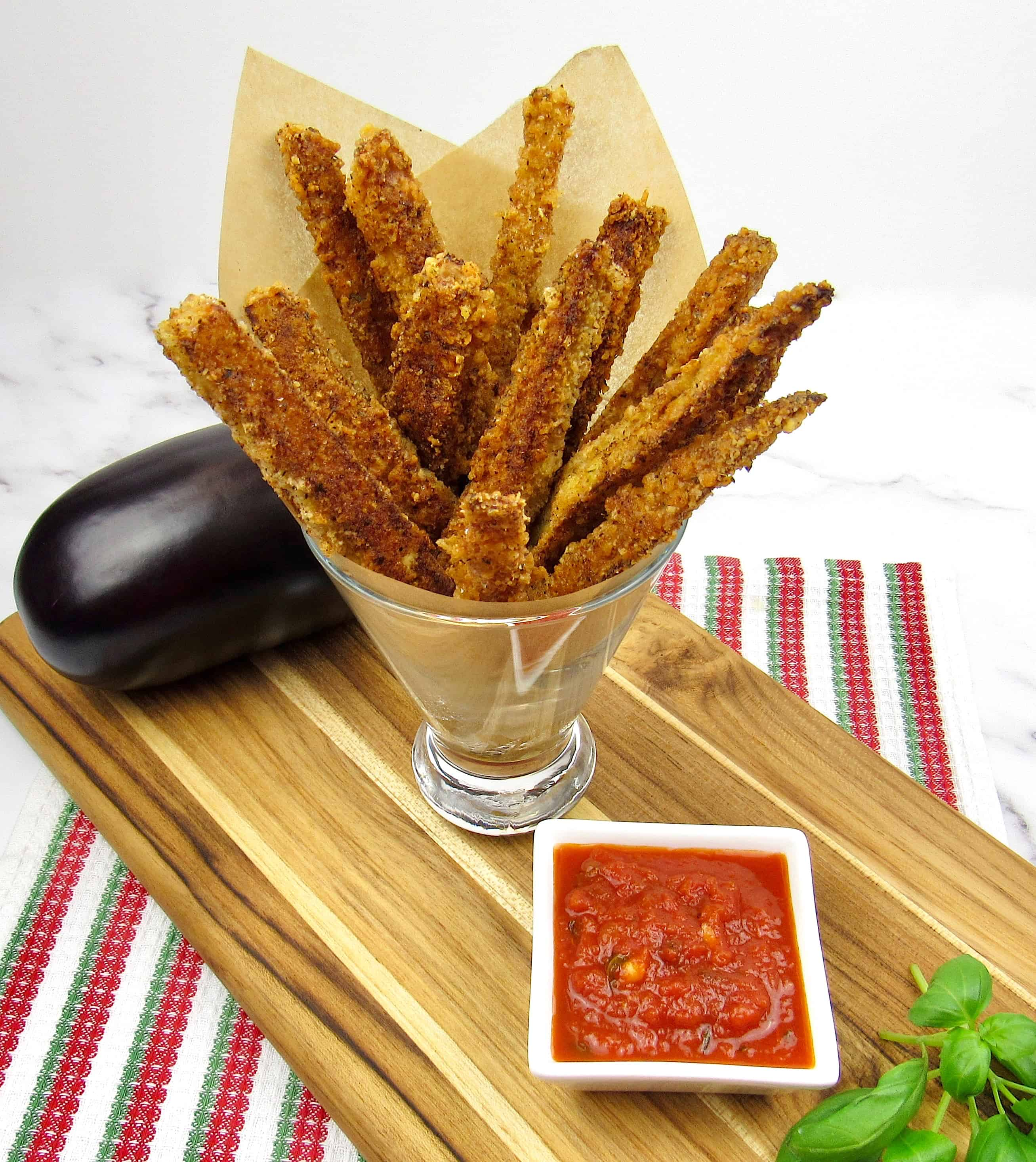 eggplant fries in glass with marinara on side