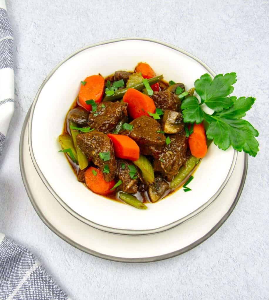 overhead view of beef stew in white bowl