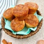closeup overhead view of snickerdoodle muffins in a brown basket