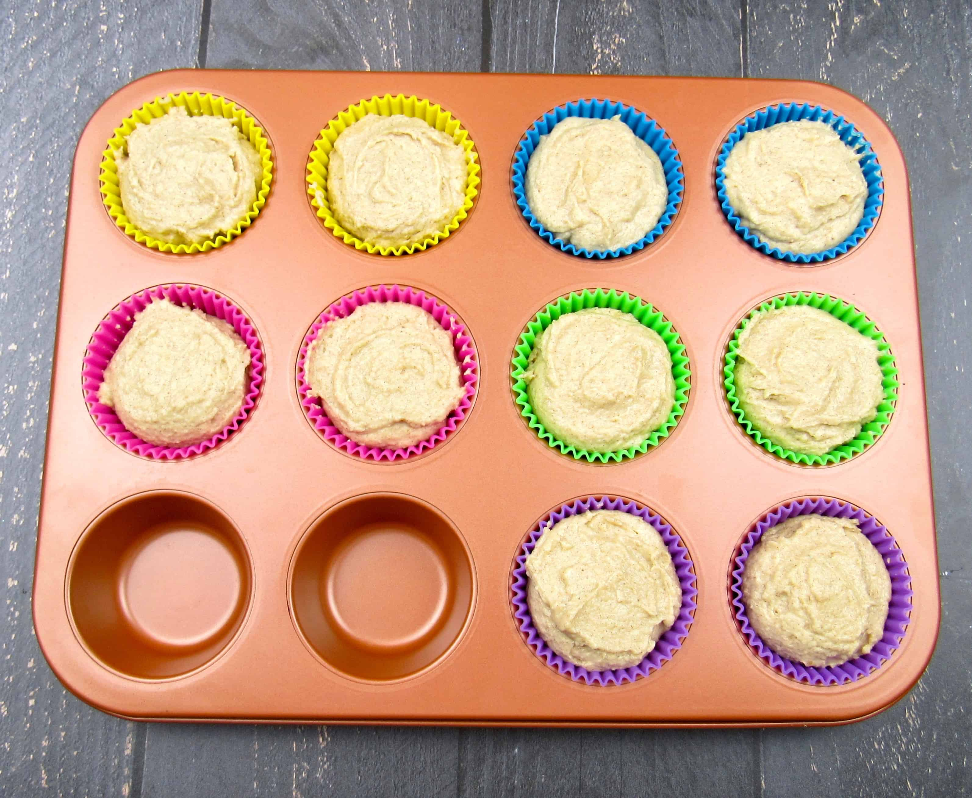 snickerdoodle muffins batter in muffin liners unbaked