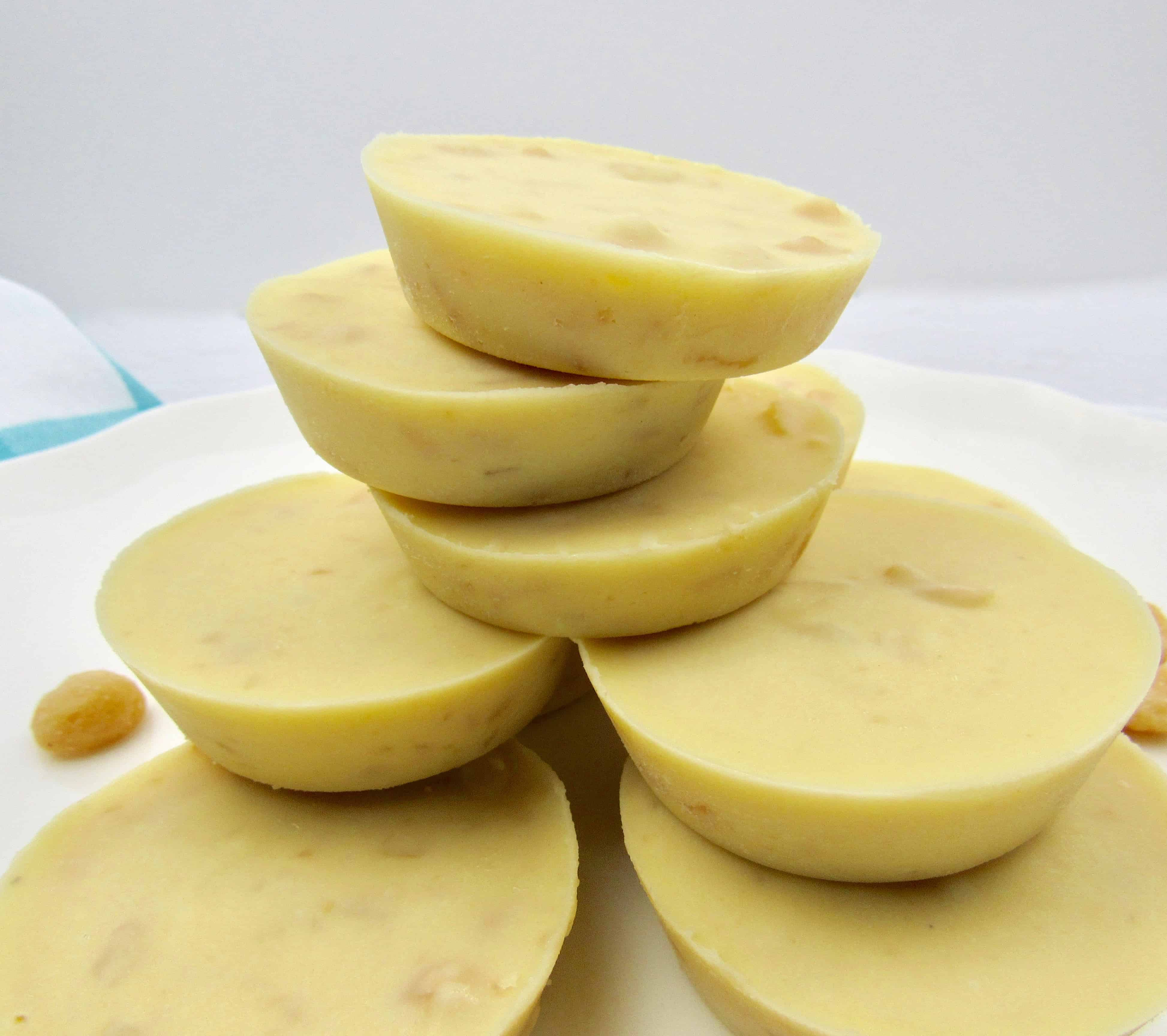 stacked white chocolate macadamia nuts on white plate