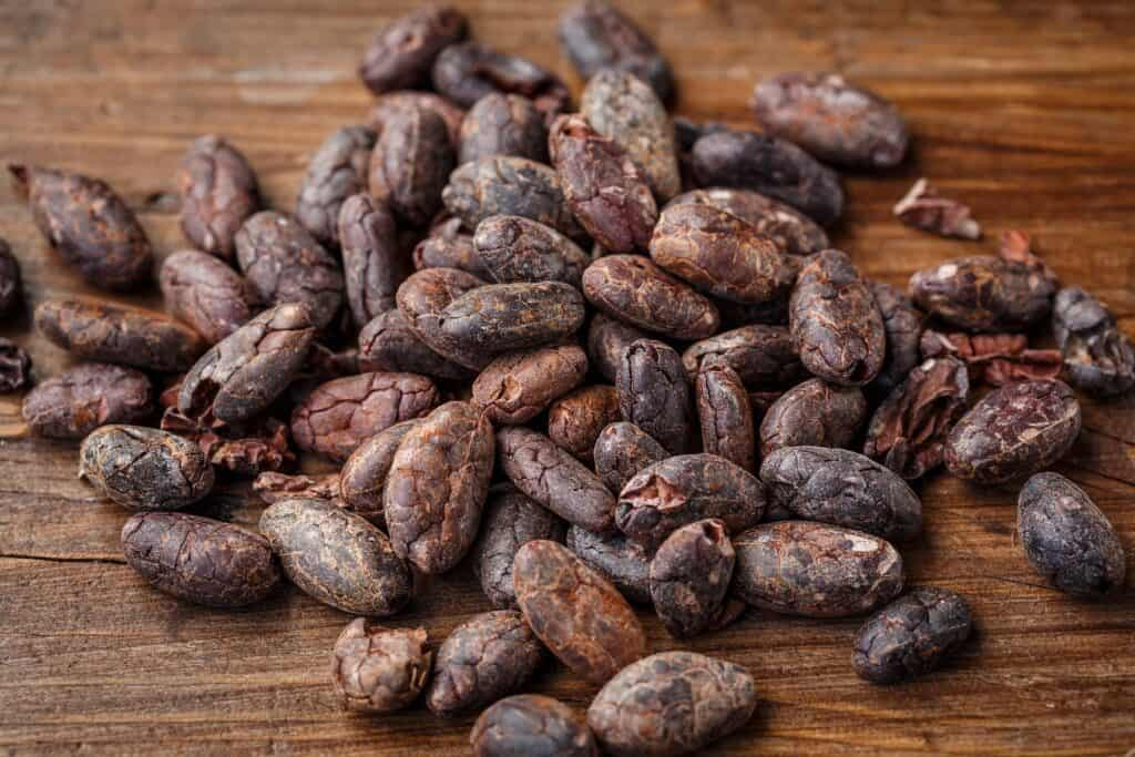 cacao beans on a wooden board