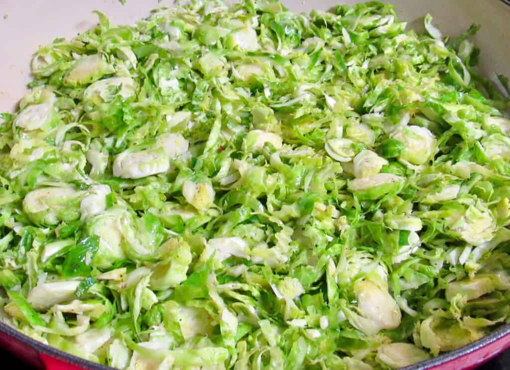 shredded Brussels sprouts frying in skillet