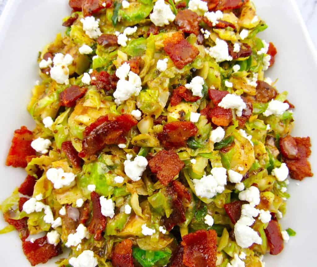 closeup of Brussels Sprouts with Hot Bacon Dressing with goat cheese