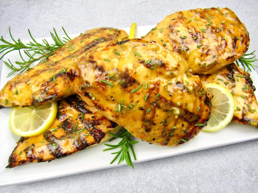 closeup of grilled chicken with citrus glaze